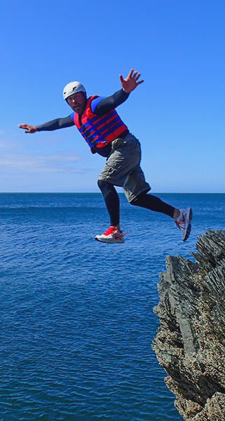 Man appears to be levitating as he jumps off a cliff